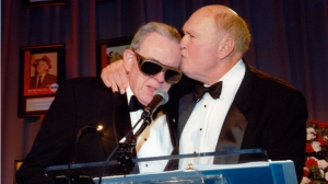 Walker gets a kiss from Scott at the Radio Hall of Fame ceremony honoring Walker in 2010.